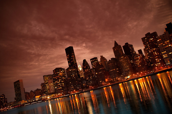 http://www.hdwallpapers.in/manhattan_nyc_reflections-wallpapers.html