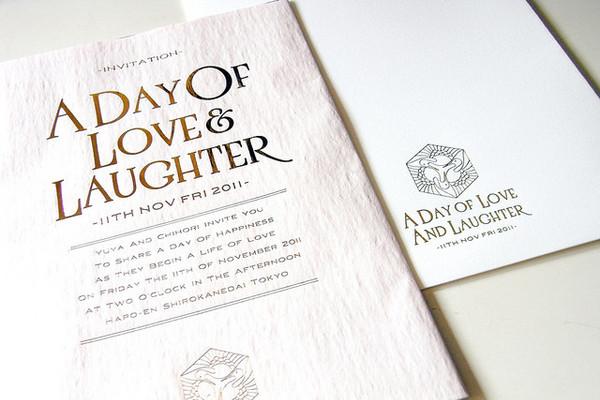 white invitation gold lettering print work