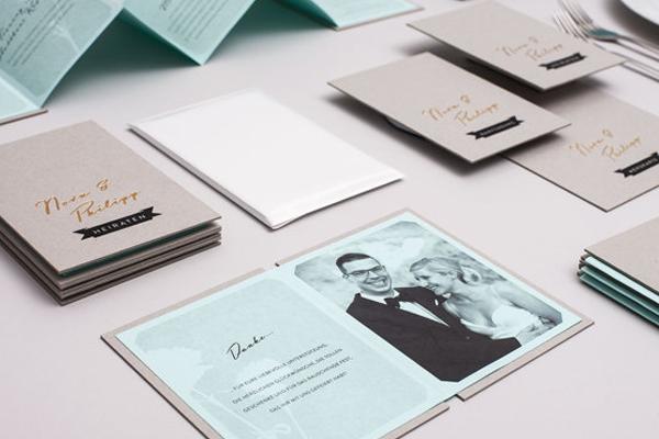 green cardboard packaging wedding invitation