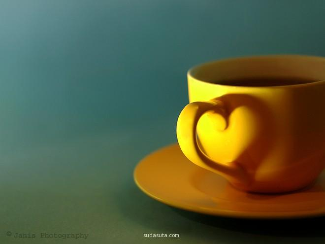 A tea cup with shadow creating a heart.