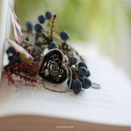 A piece of artificial jewelry lying on a book in summer.