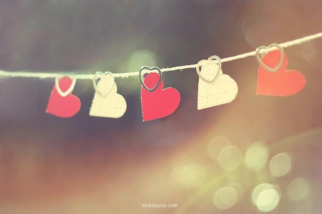 Love picture of summer with paper hearts on a string.