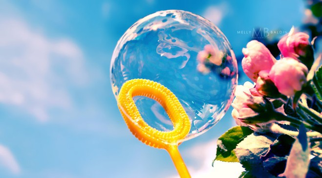 Summer picture. A soap bubble tells all about summer.