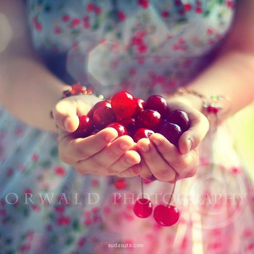 a girl carrying berries in her hand.