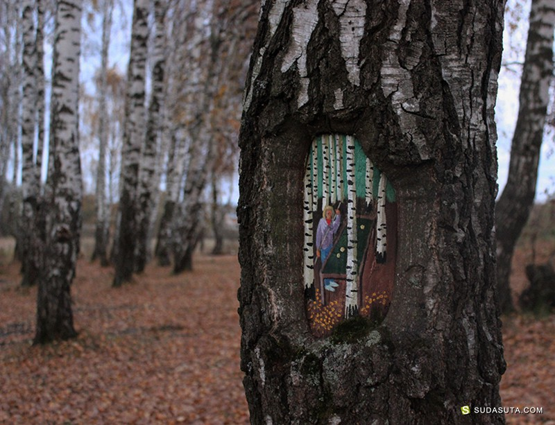 Dudnikova Eugene 在树干上绘画